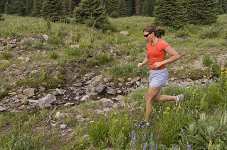Gabby Anstey trail running the West Fork Trail in the San Juan Mountains. Big Blue Wilderness, Colorado.